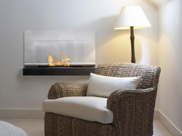 Ferrum - Wall Mount Ventless Ethanol Fireplace on a Wall